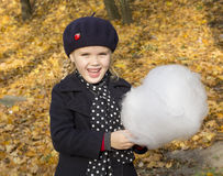 Beautiful girl eating cotton candy Royalty Free Stock Image
