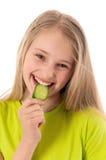 Beautiful girl eating cucumber Stock Photo
