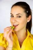 Beautiful girl eating fresh kiwi smiling happy Royalty Free Stock Photography