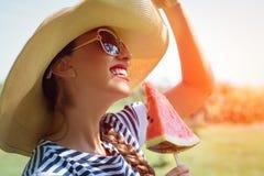 Beautiful girl eating fresh watermelon Stock Photos