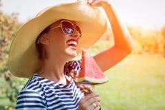Beautiful girl eating fresh watermelon Stock Images