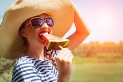 Beautiful girl eating fresh watermelon Royalty Free Stock Photography