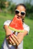 Beautiful girl eating fresh watermelon Stock Image
