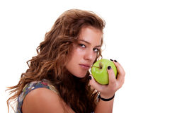 Beautiful girl eating a green apple Royalty Free Stock Photo