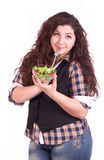 A beautiful girl eating healthy food Stock Image