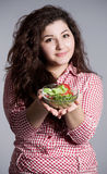 Beautiful girl eating healthy food Stock Photography