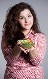 Beautiful girl eating healthy food Stock Photography