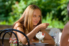 Beautiful Girl Eating Ice Scream Stock Images