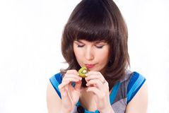 Beautiful girl eating kiwi isolated Royalty Free Stock Photo
