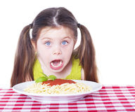 Beautiful girl eating pasta Royalty Free Stock Images