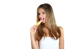 Beautiful girl eating a popsicle Stock Photos