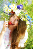 Beautiful girl eating strawberry Royalty Free Stock Images