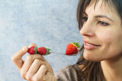 Beautiful girl eating strawberry Stock Image