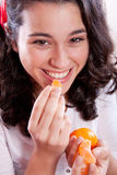 Beautiful Girl Eating Tangerines Stock Image