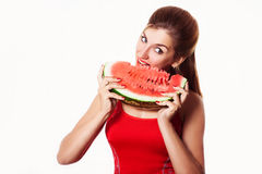 Beautiful girl eating watermelon in studio. Isolated on white. Stock Photo