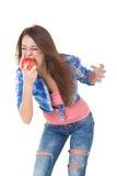 Beautiful girl eats an apple Stock Photos