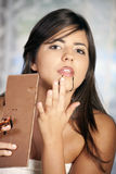 Beautiful girl eats chocolate Royalty Free Stock Image