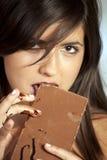 Beautiful girl eats chocolate Royalty Free Stock Photo