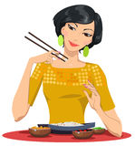 Beautiful girl eats with chopsticks Stock Photos