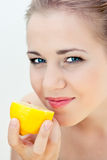 Beautiful girl eats a lemon Royalty Free Stock Images