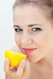 Beautiful girl eats a lemon Royalty Free Stock Images