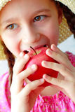 Beautiful girl eats orange Stock Photography