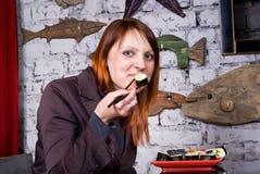 Beautiful girl eats sushi Royalty Free Stock Photo