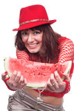 The beautiful girl eats a wate Stock Images
