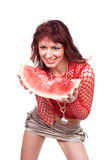 The beautiful girl eats a water-melon Stock Image