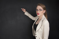 Beautiful girl in elegant clothes for business or student collage concept. Girl and black board writing on it about business concept or teaching school royalty free stock photography