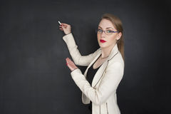 Beautiful girl in elegant clothes for business or student collage concept. Girl and black board writing on it about business concept or teaching school stock image