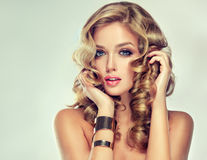 Beautiful girl with an elegant hairstyle. royalty free stock image