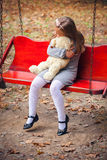 Beautiful girl embraces an amusing bear Stock Photography