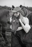 Beautiful girl embraces a foal Royalty Free Stock Image