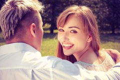 Beautiful girl embraces the guy Royalty Free Stock Photo