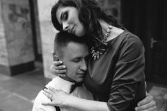 Beautiful girl embraces her boyfriend Royalty Free Stock Image