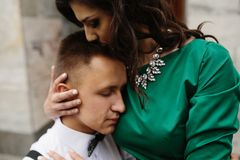 Beautiful girl embraces her boyfriend Royalty Free Stock Images
