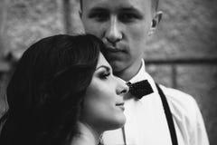 Beautiful girl embraces her boyfriend Stock Photo