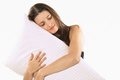 Beautiful girl embraces her pillow Royalty Free Stock Photography