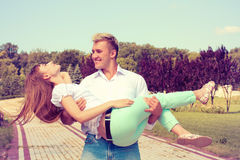 Beautiful Girl Embraces The Guy Royalty Free Stock Images