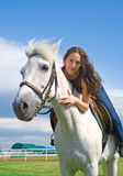Beautiful girl embraces a white horse Royalty Free Stock Photo