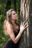 Beautiful girl embracing tree Stock Photography