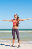 Beautiful girl is engaged in yoga on the beach Stock Images