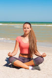 Beautiful girl is engaged in yoga on the beach Royalty Free Stock Photos