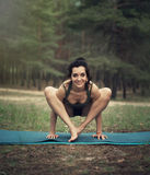 Beautiful girl is engaged in yoga in the forest Stock Images