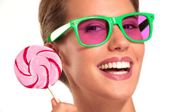 Beautiful girl enjoy a big colorful candy Stock Image