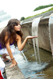 Beautiful girl enjoy the cool water Royalty Free Stock Image