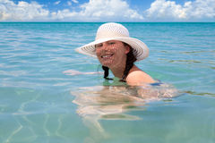 Beautiful girl enjoy sunny day at Caribbean beach. Stock Images