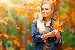 Beautiful girl enjoying autumn holidays Stock Photo