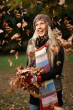 Beautiful girl enjoying autumn in park laughing Stock Images